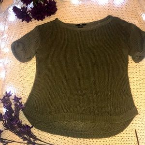 This is a short sleeve army green sweater.